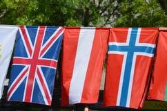 As bandeiras de Reino Unido, de Letónia e de Noruega fotografia de stock