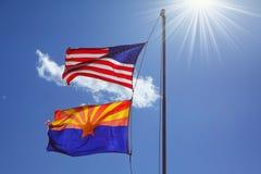 As bandeiras estão de encontro ao sol de brilho Imagens de Stock