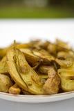 As batatas Roasted o peixe pequeno Fotos de Stock Royalty Free