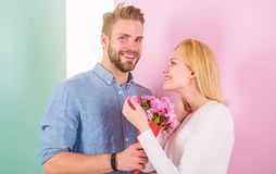 They are as beautiful as you Boyfriend bring bouquet flowers to surprise her. Romantic gift concept. Man giving. Beautiful flower to lovely pretty woman. Every royalty free stock photos