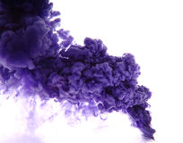 As a blue smoke. Blue paint in the water as a smoke on white background Stock Images