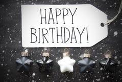 As bolas pretas do Natal, flocos de neve, Text o feliz aniversario Imagem de Stock