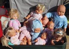 As bonecas na mala de viagem Fotos de Stock
