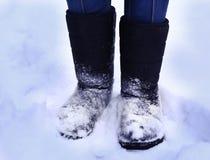 As botas altas do inverno fecham-se acima da foto Imagem de Stock