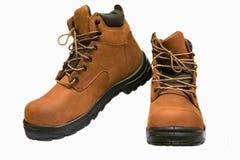 As botas da segurança isoladas no fundo branco, fim acima das botas novas no fundo branco, trabalhador usaram a sapata das botas  Fotografia de Stock