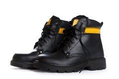 As botas de couro do preto alto do trabalho no fundo branco Imagens de Stock Royalty Free
