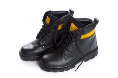 As botas de couro do preto alto do trabalho no fundo branco Fotografia de Stock Royalty Free