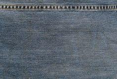 As calças de brim Texture com linha de costura Foto de Stock