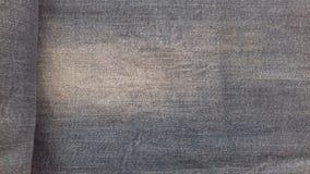 As calças de brim vazias texture o fundo da sarja de Nimes de matéria têxtil do vintage do grunge Imagem de Stock