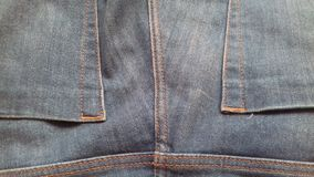 As calças de brim vazias texture o fundo da sarja de Nimes de matéria têxtil do vintage do grunge Foto de Stock Royalty Free