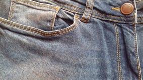 As calças de brim vazias texture o fundo da sarja de Nimes de matéria têxtil do vintage do grunge Fotografia de Stock