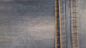 As calças de brim vazias texture o fundo da sarja de Nimes de matéria têxtil do vintage do grunge Imagens de Stock