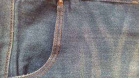 As calças de brim vazias texture o fundo da sarja de Nimes de matéria têxtil do vintage do grunge Fotos de Stock