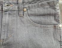 As calças de brim velhas da tela pocket a cor cinzenta preta, textura Foto de Stock