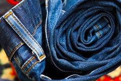 As calças de brim constringiram em um rolo Foto de Stock