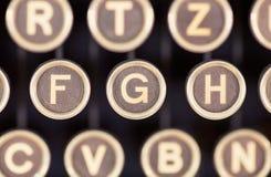 As chaves velhas das máquinas de escrever fecham-se acima imagens de stock royalty free