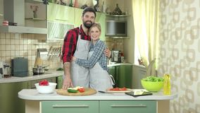 as chopped cooking counter couple each framed happily happy horizontally kitchen look near other pepper photograph smiling stove απόθεμα βίντεο
