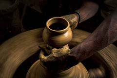 As the clay pot takes shape Stock Photo