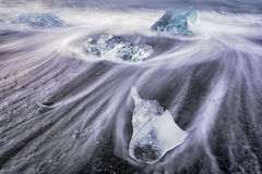 As cold as Ice - Blue Ice on the beach Glacier Lagoon Sunrise Royalty Free Stock Photos