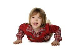 As configurações do rapaz pequeno em um assoalho imagens de stock