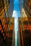 As construções douradas do negócio abrigam a cidade em Tsim Sha Tsui Fotos de Stock