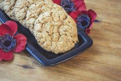 As cookies australianas Anzac com dia de Anzac assim que nós não esquecem Fotos de Stock Royalty Free
