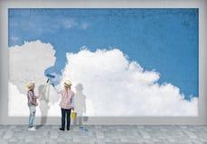As crianças pintam a parede Imagens de Stock