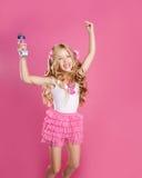As crianças pouco cantor da estrela gostam da boneca da forma Foto de Stock