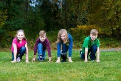 As crianças alinharam pronto para competir Fotografia de Stock Royalty Free