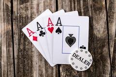 As - cuatro de un póker de la clase foto de archivo