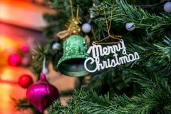 As decorações do Natal, casam o Natal na árvore de Natal Imagem de Stock