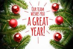 As decorações do Natal com o ` da mensagem nossa equipe desejam-lhe um grande ano! ` Imagem de Stock Royalty Free