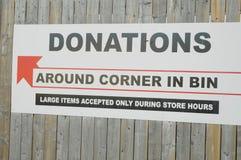 As doações deixam cair fora o Signage Fotografia de Stock Royalty Free