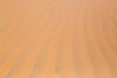 as dunas de areia vermelhas do deserto texture o teste padrão vermelho da textura das dunas de areia do deserto do teste padrão n Imagem de Stock Royalty Free