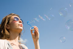 As easy as blowing bubbles. Royalty Free Stock Image