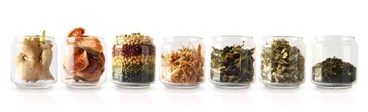 As ervas tailandesas estão nas garrafas de vidro fotos de stock royalty free