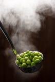 As ervilhas verdes fervidas Imagens de Stock
