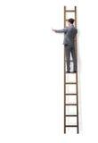 As escadas de escalada do homem de negócios isoladas no branco fotos de stock royalty free