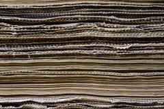As espinhas dos livros velhos que encontram-se na pilha Livros empilhados no Imagem de Stock Royalty Free