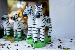 As estátuas pequenas da zebra para rezam o deus Fotografia de Stock