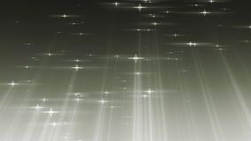 As estrelas das part?culas com raios iluminam o fundo dado la?os video estoque