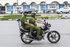 Police on the street of Ho Chi Minh. As everybody else Vietnamese police use motorbike for the transportation as it is main mean of transport in Vietnam royalty free stock photography