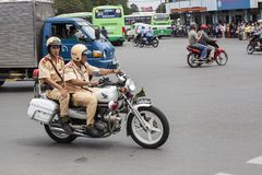 Police on the street of Ho Chi Minh. As everybody else Vietnamese police use motorbike for the transportation as it is main mean of transport in Vietnam royalty free stock photos