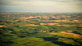As explorações agrícolas pontilham o Palouse do montículo de Steptoe no nascer do sol Imagem de Stock Royalty Free