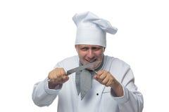 As facas do cozinheiro chefe nas mãos exultam Imagens de Stock