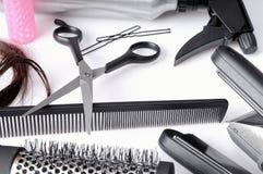As ferramentas do cabeleireiro da composição isolaram a vista superior imagem de stock