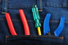 As ferramentas nas calças de brim suportam o bolso 1 Foto de Stock Royalty Free