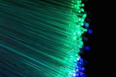 As fibras óticas iluminam o fundo abstrato, fundo ótico da fibra imagens de stock
