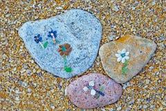 As flores fizeram escudos do ââof Imagens de Stock
