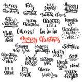 As folhas de prova da foto das frases da caligrafia do feriado do Natal da rotulação e do ano novo ajustaram-se isolado no fundo  ilustração royalty free